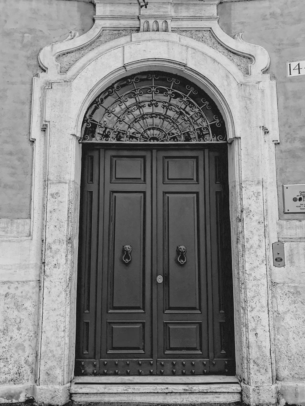 grayscale photography of closed wooden door