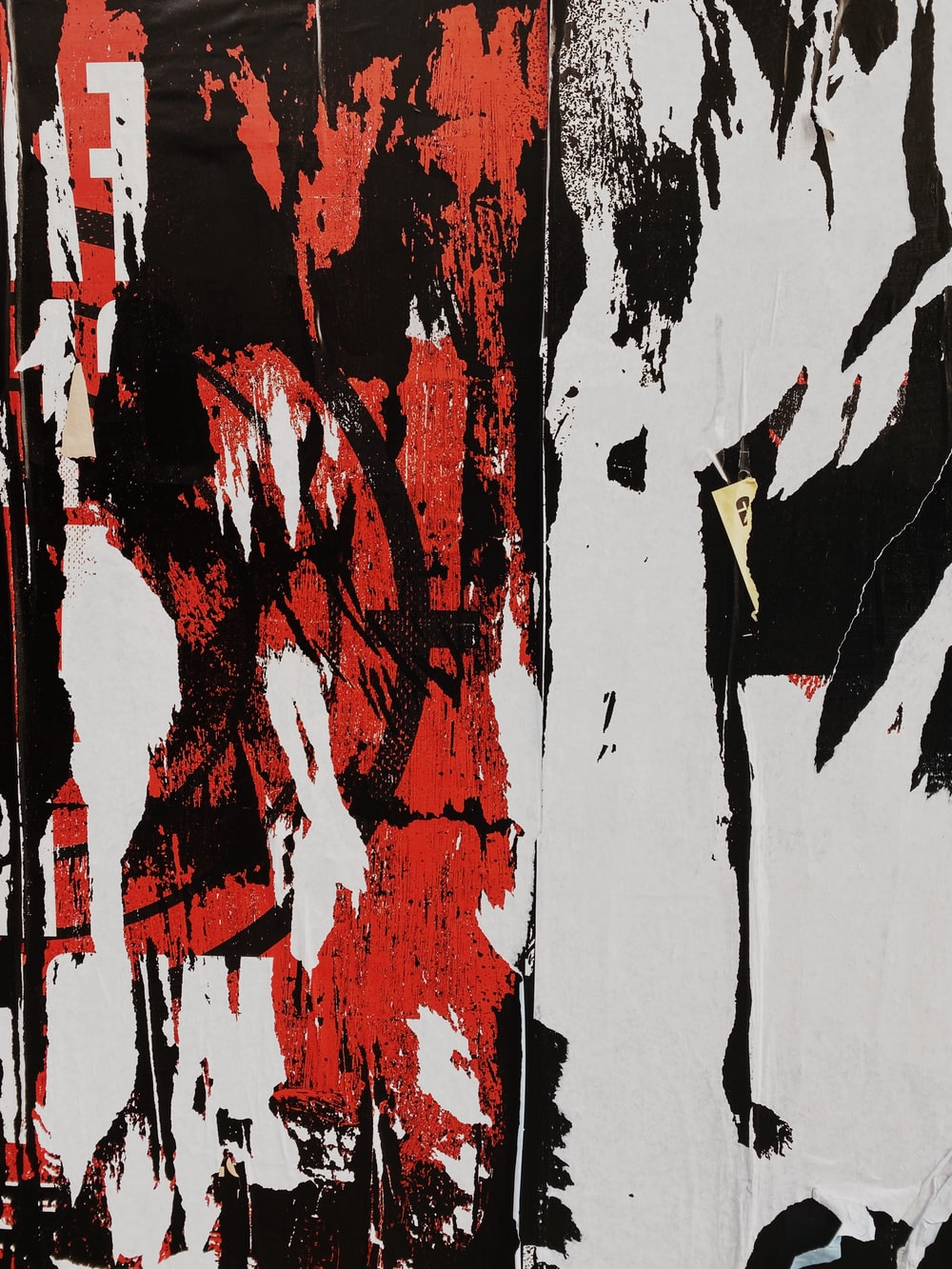 black, white, and red abstract painting