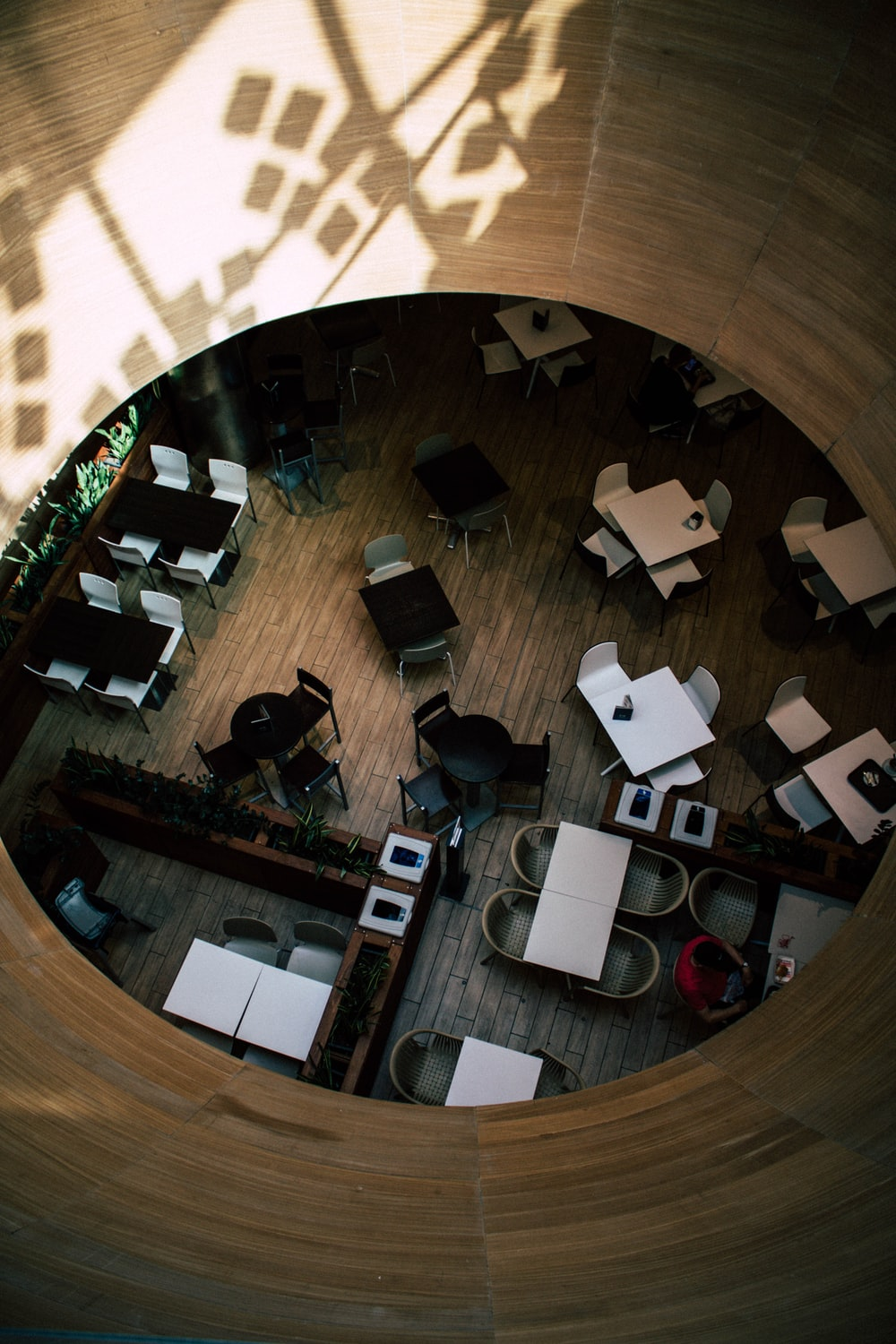 high-angle photography of tables and chairs