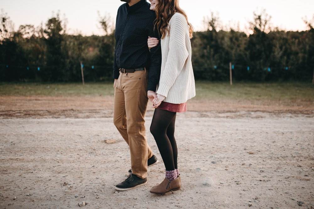 woman and man standing on road