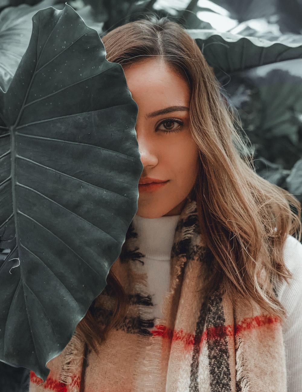 woman behind leaf