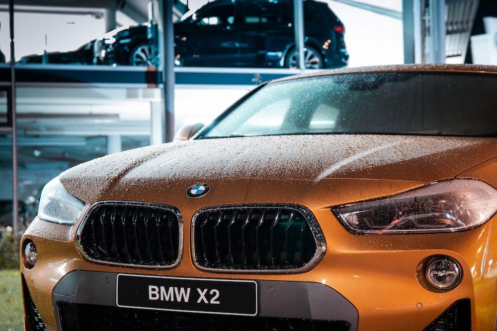 orange BMW vehicle during daytime
