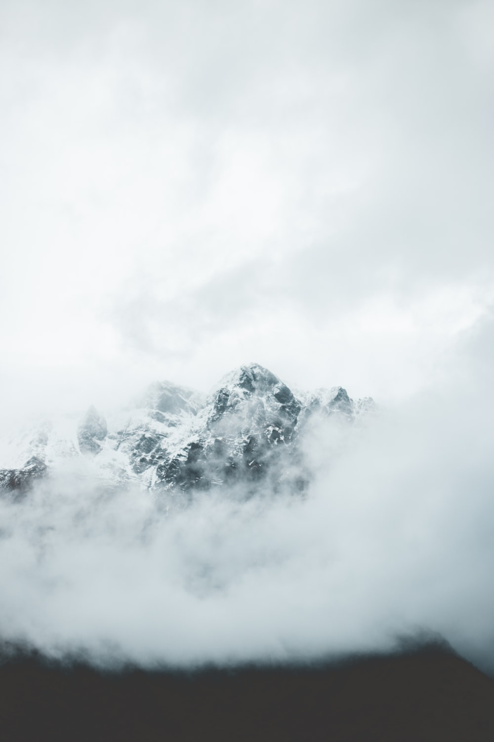 white mountain covered in clouds
