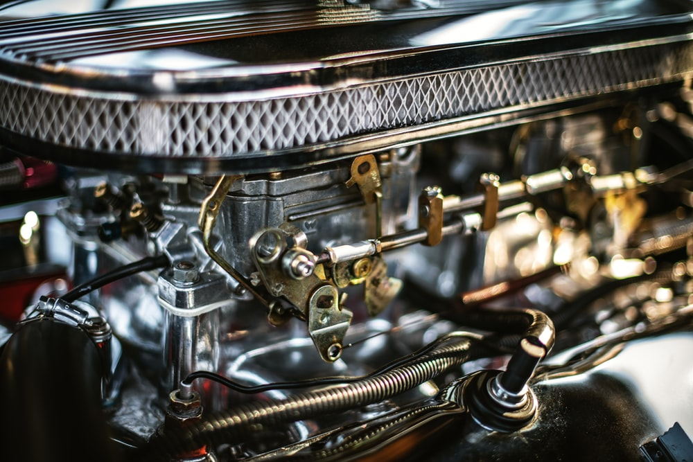 selective focus photography of gray engine