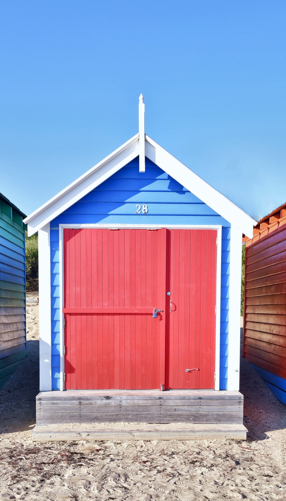 red and blue wooden house