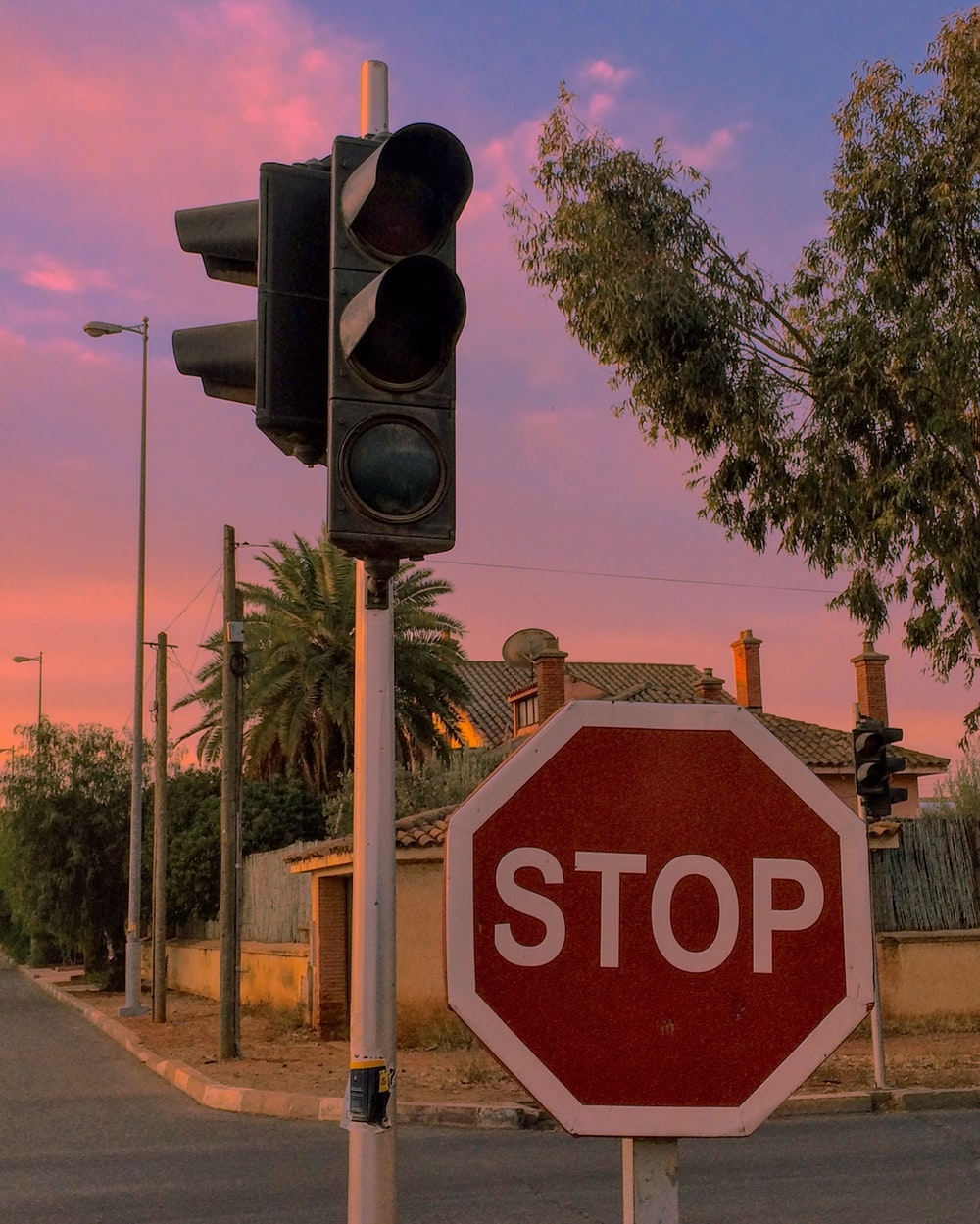red and white Stop signage and black traffic light