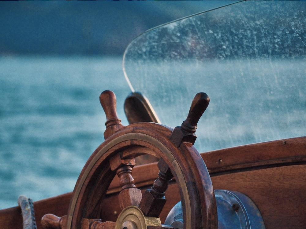 brown wooden ship steering wheel