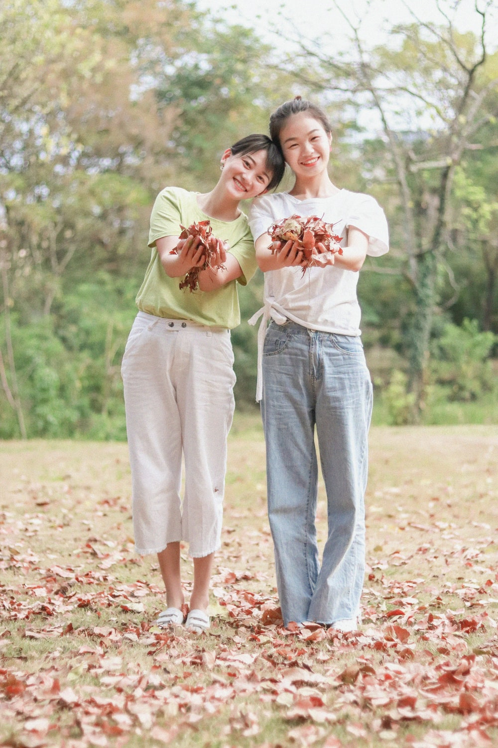 2 girls holding dried leaves