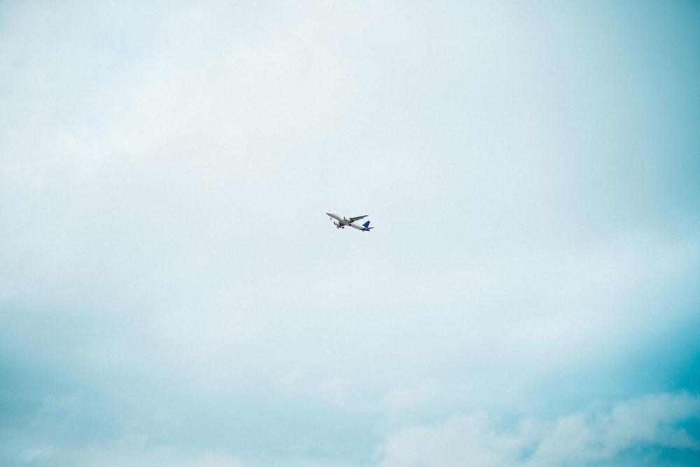 airplane in mid air during day