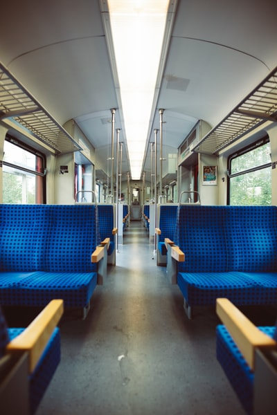 Railway with blue seats.
