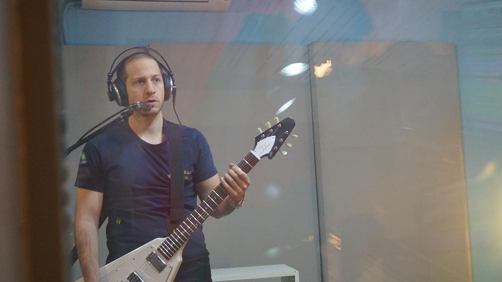 man holding stringed instrument