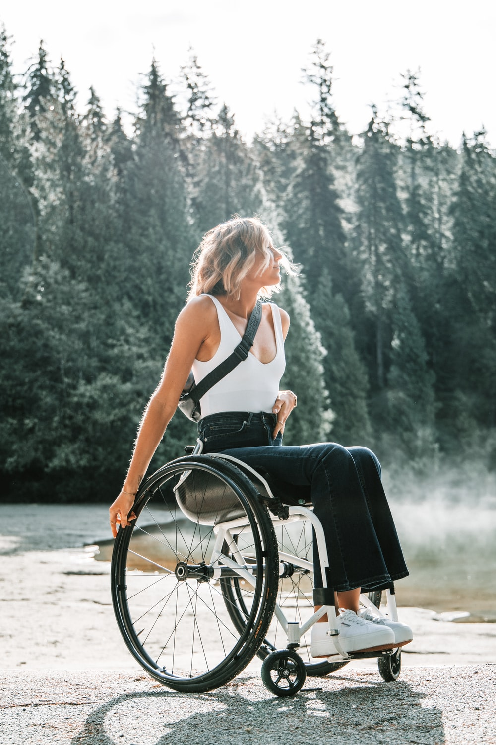 woman riding wheelchair near trees