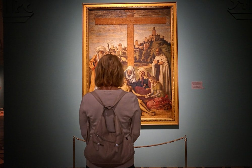 woman standing in front of painting