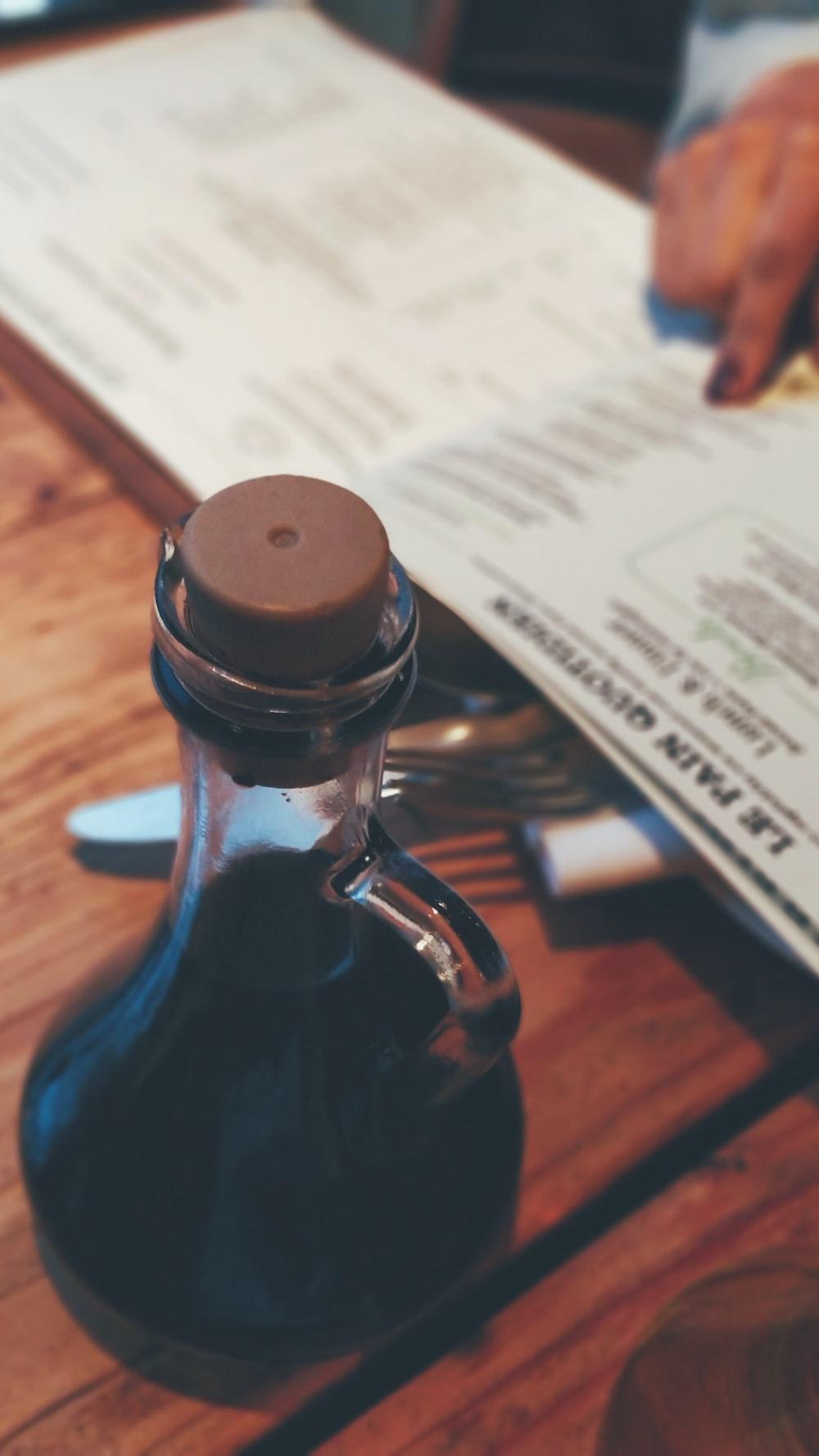 black liquid filled botlte