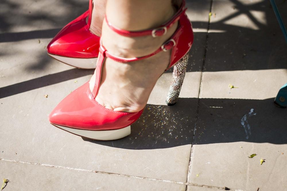 woman standing on tiled floor