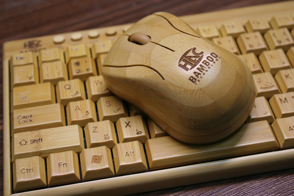 brown Bamboo wireless mouse and keyboar