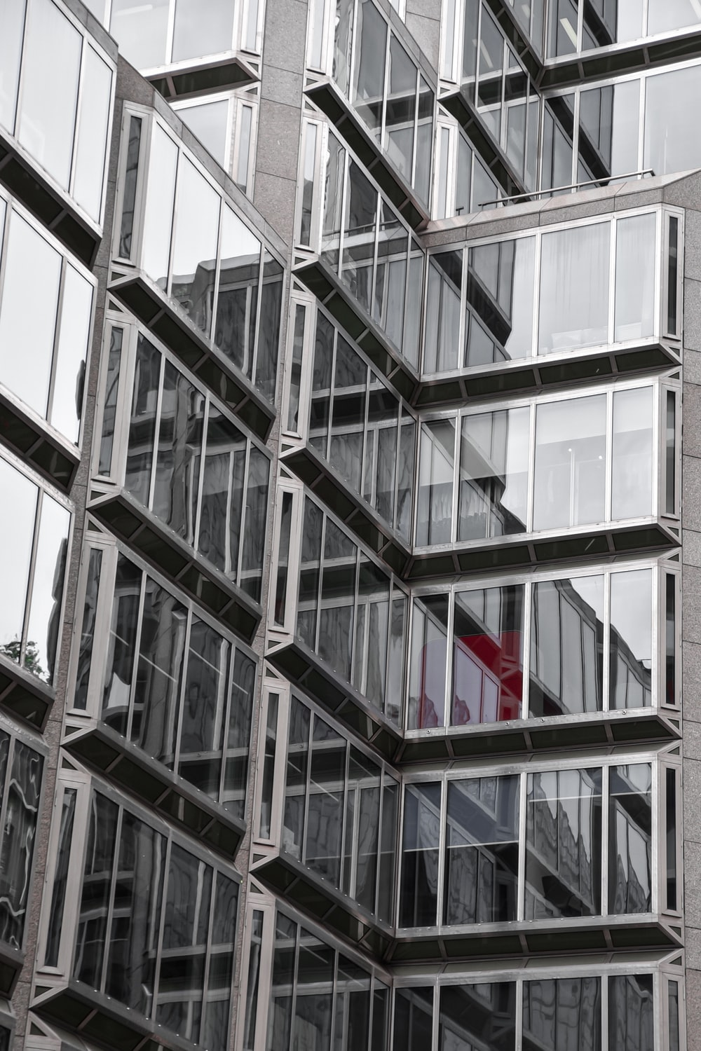 red object behind glass building wall