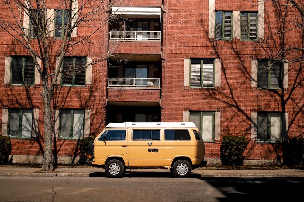 orange van outside brown brick building