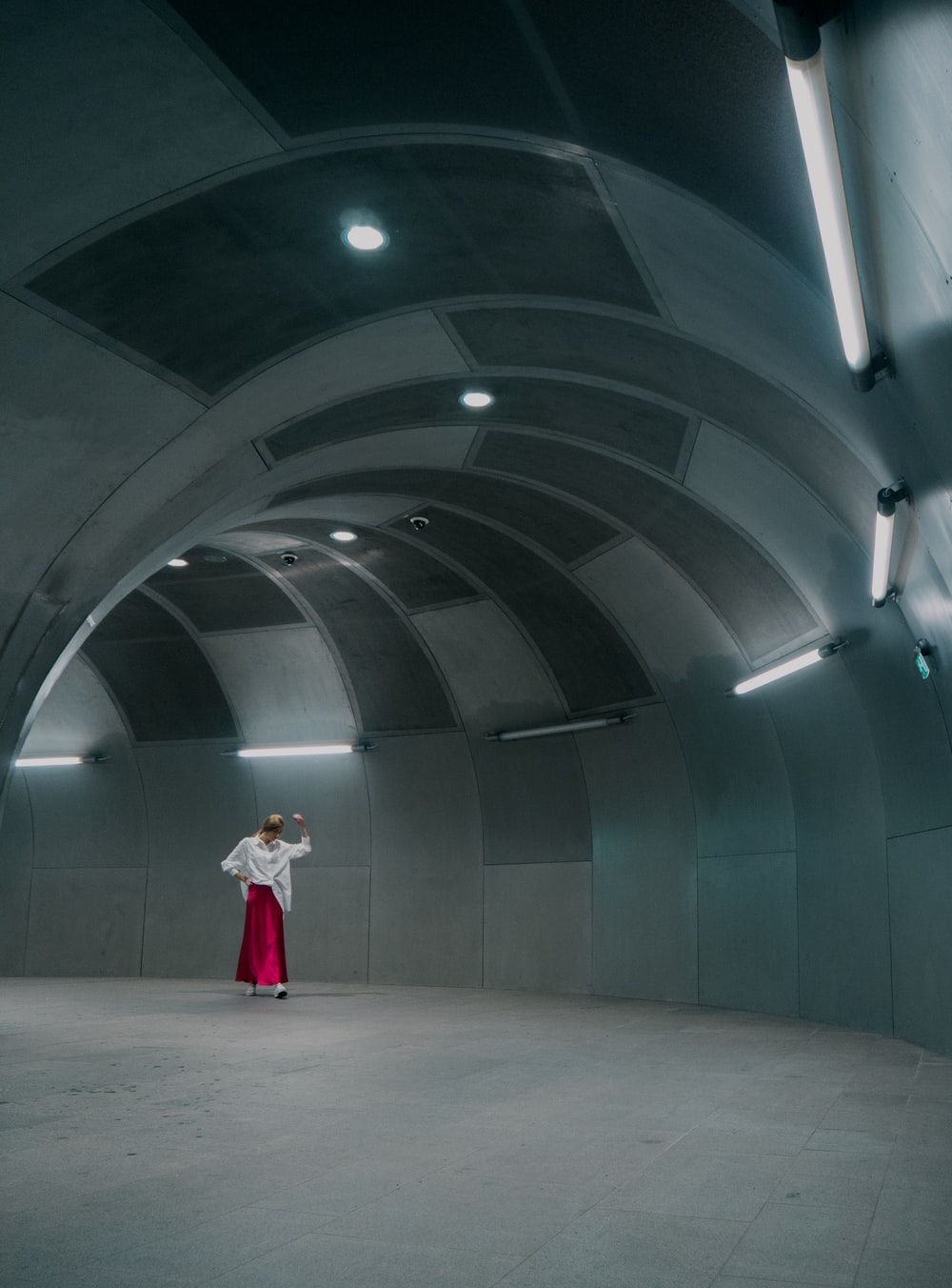 woman standing under tunnel