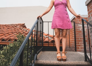 woman standing on concrete stairs