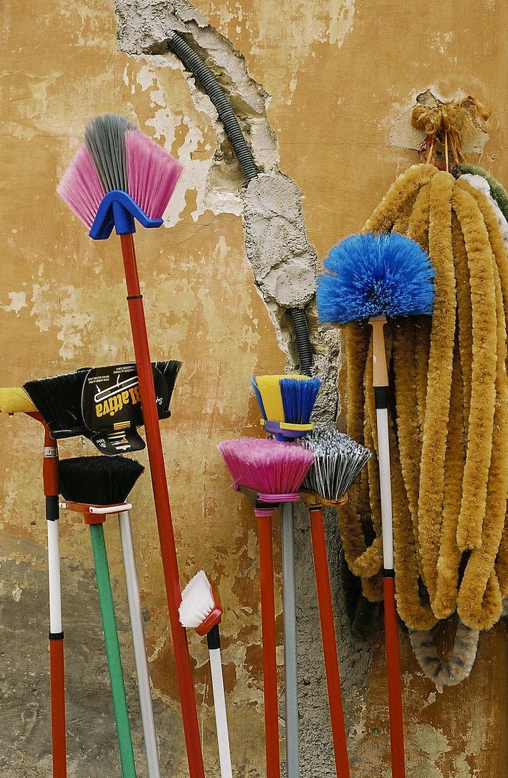 assorted-color floor brush lot