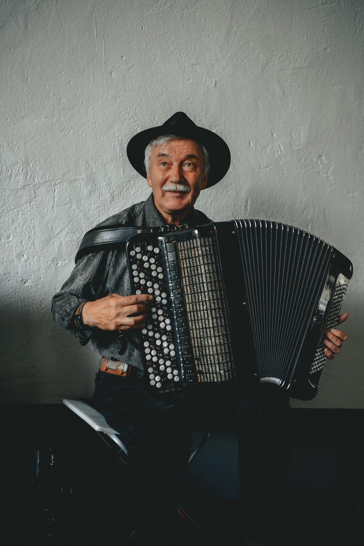 man playing musical instrument