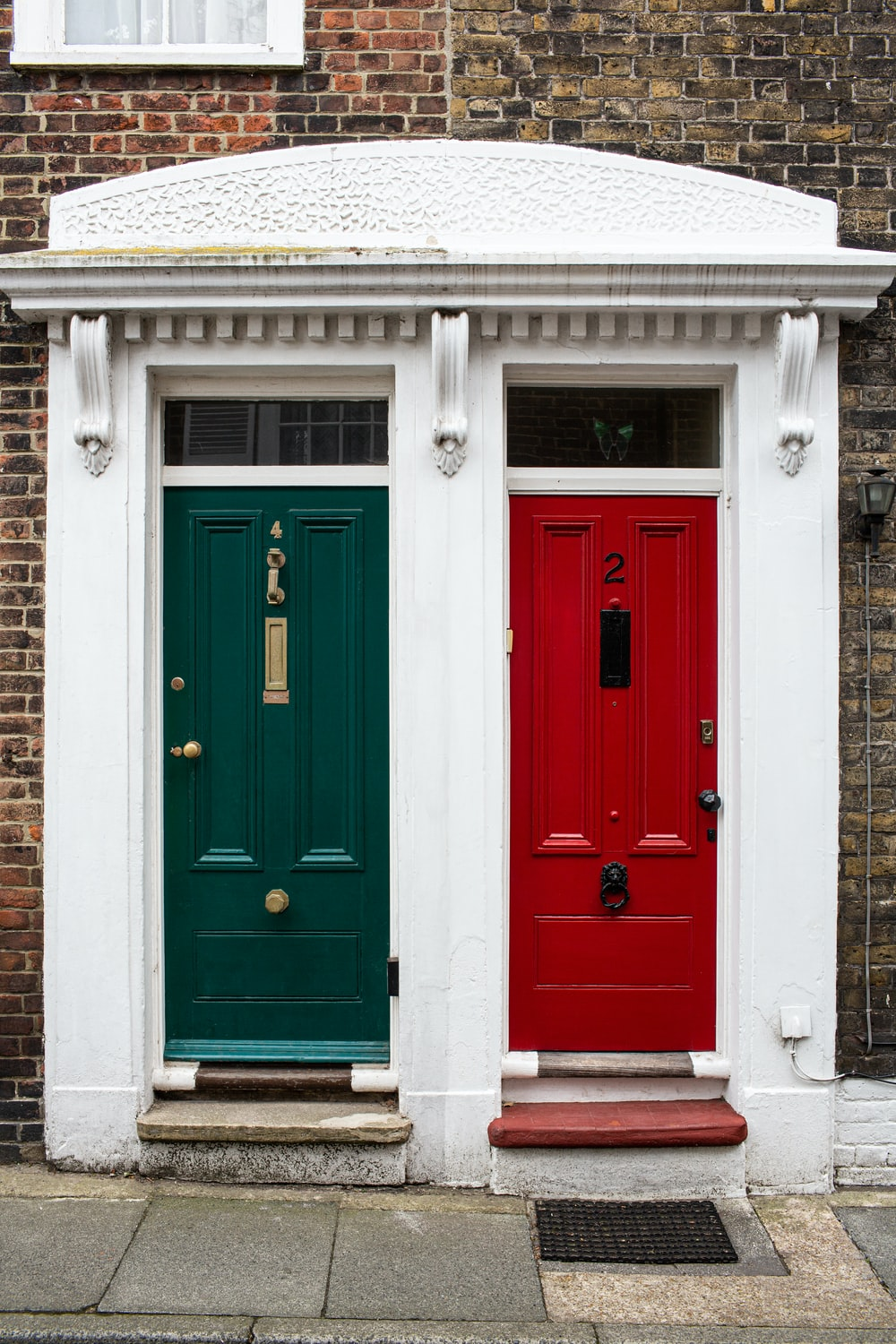 two green and red doors