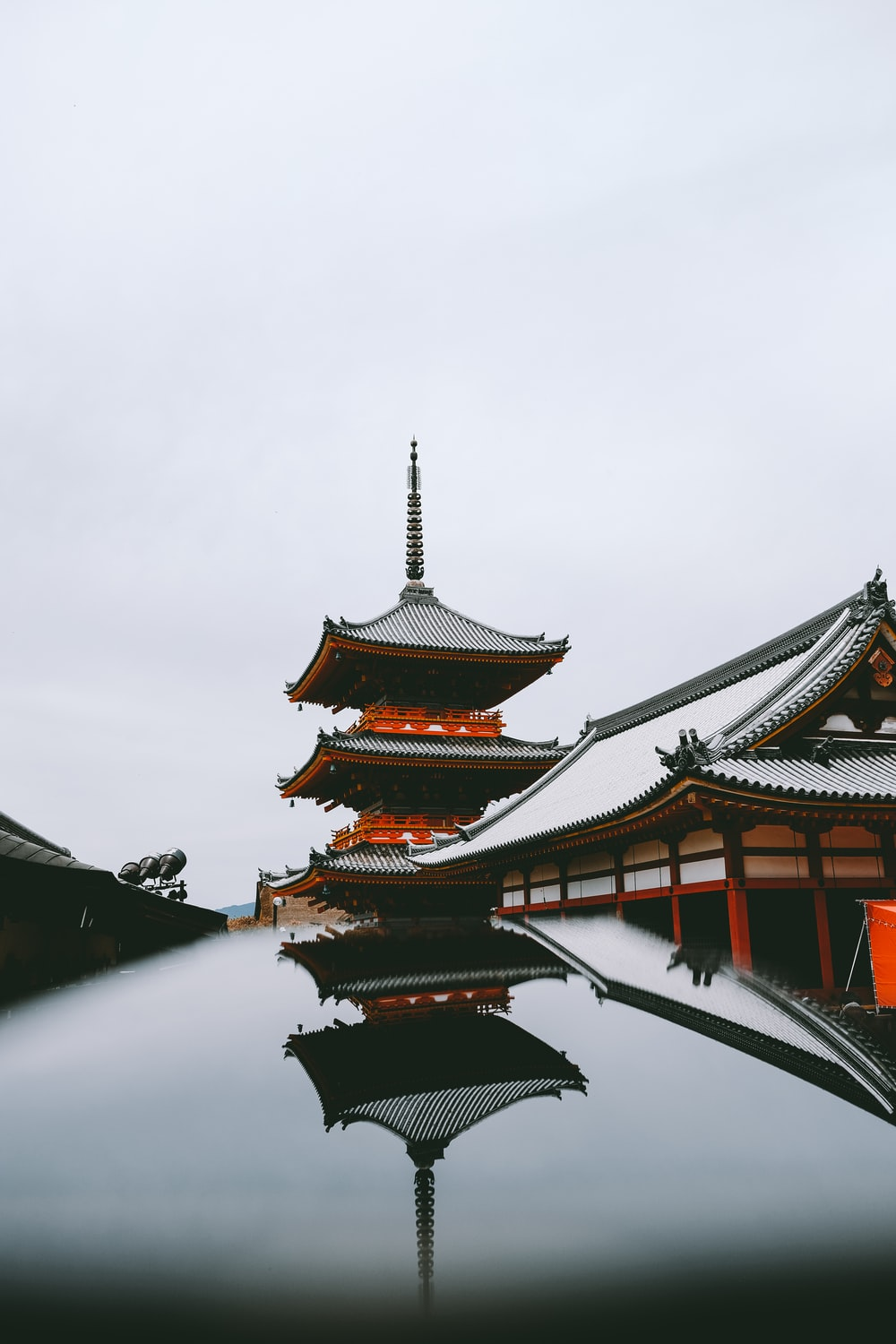 black and red temple under white sky at daytime