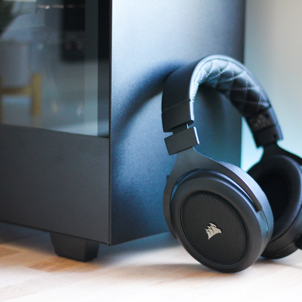 black headphones beside cabinet