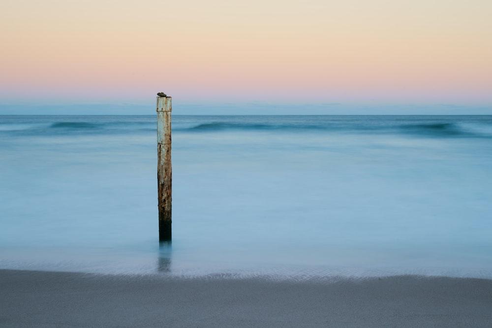 white post on shore