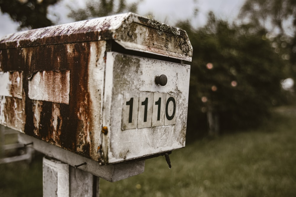white 110 wooden mail box