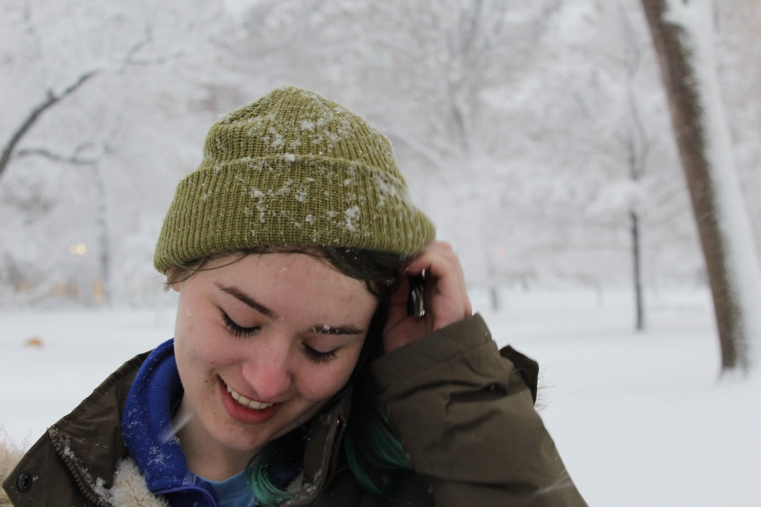 Girl laughing in snow.