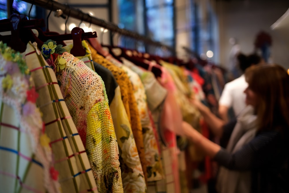 woman standing and choosing clothes