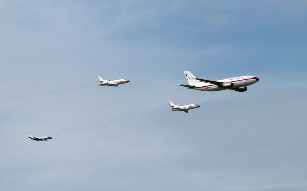 four white airliners