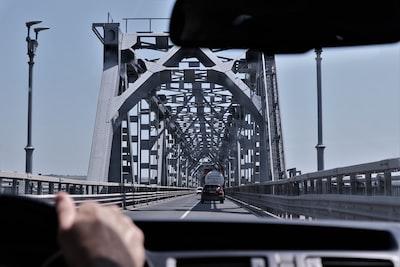 Ruse person driving vehicle on bridge