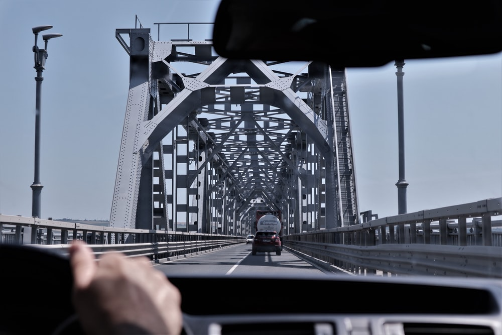 person driving vehicle on bridge