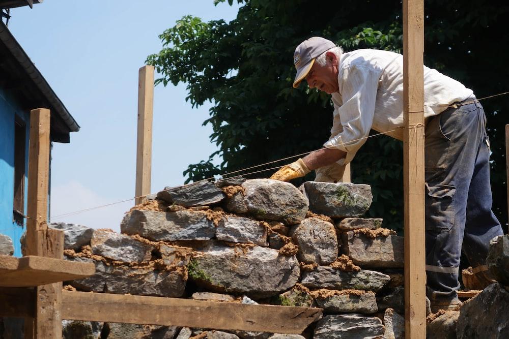 man piling bricks
