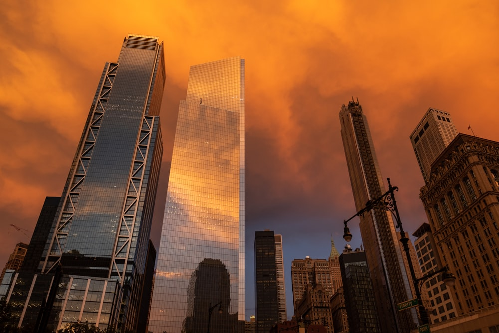 low-angle photography of high-rise buildings during sunset