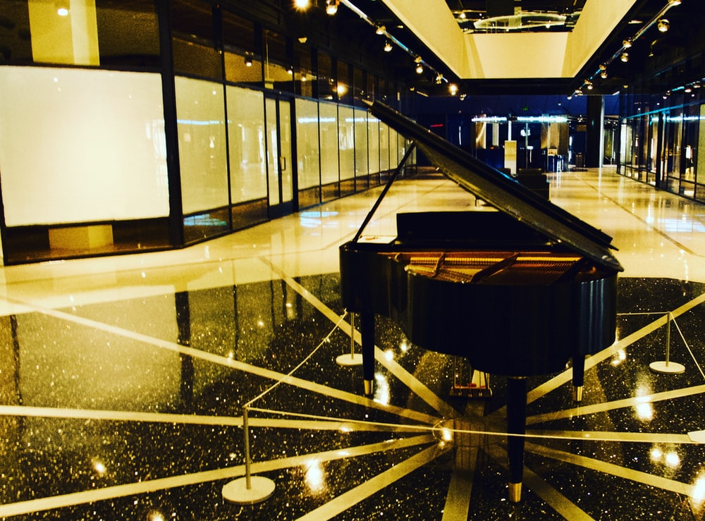 black and brown grand piano