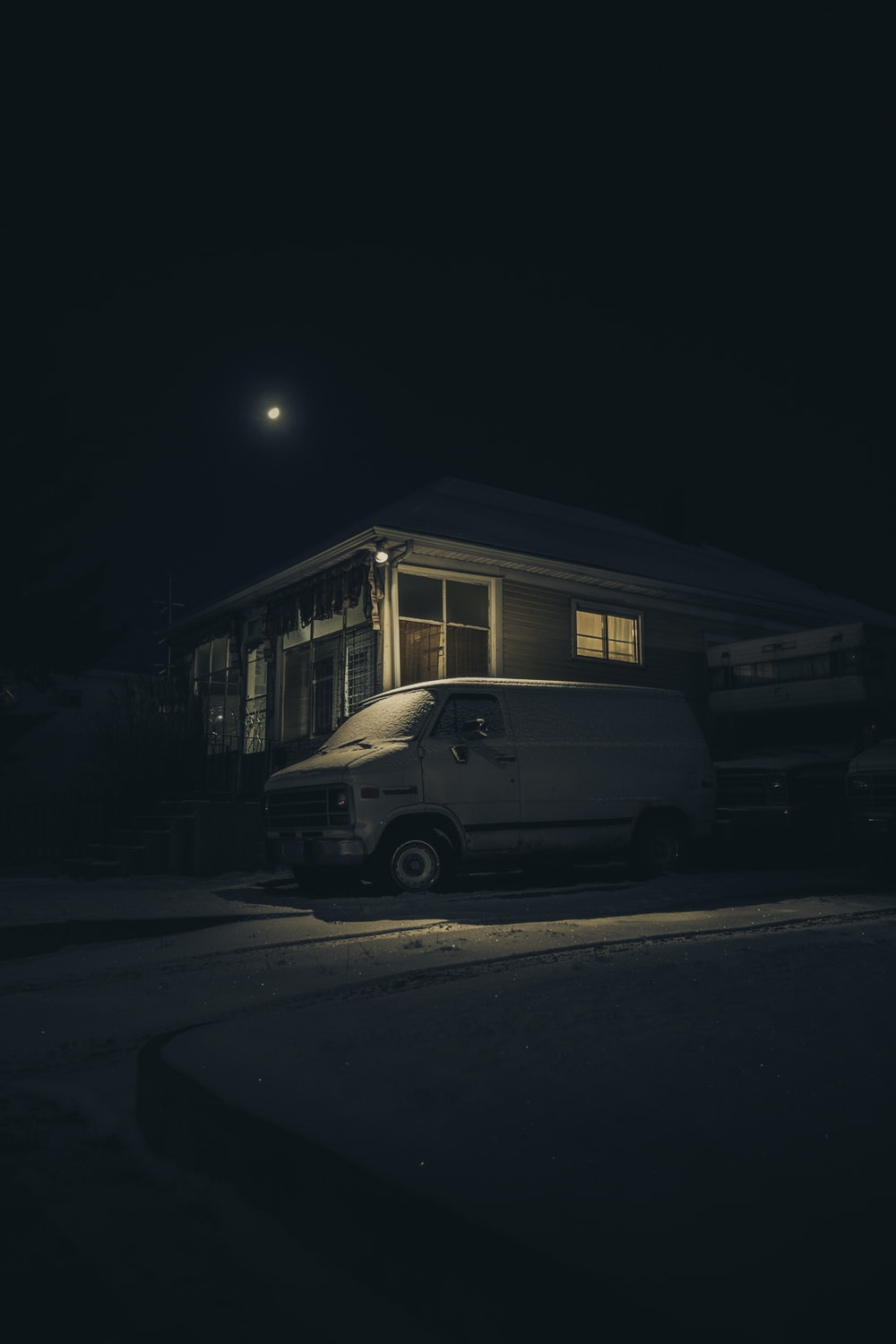 white panel van parked beside house