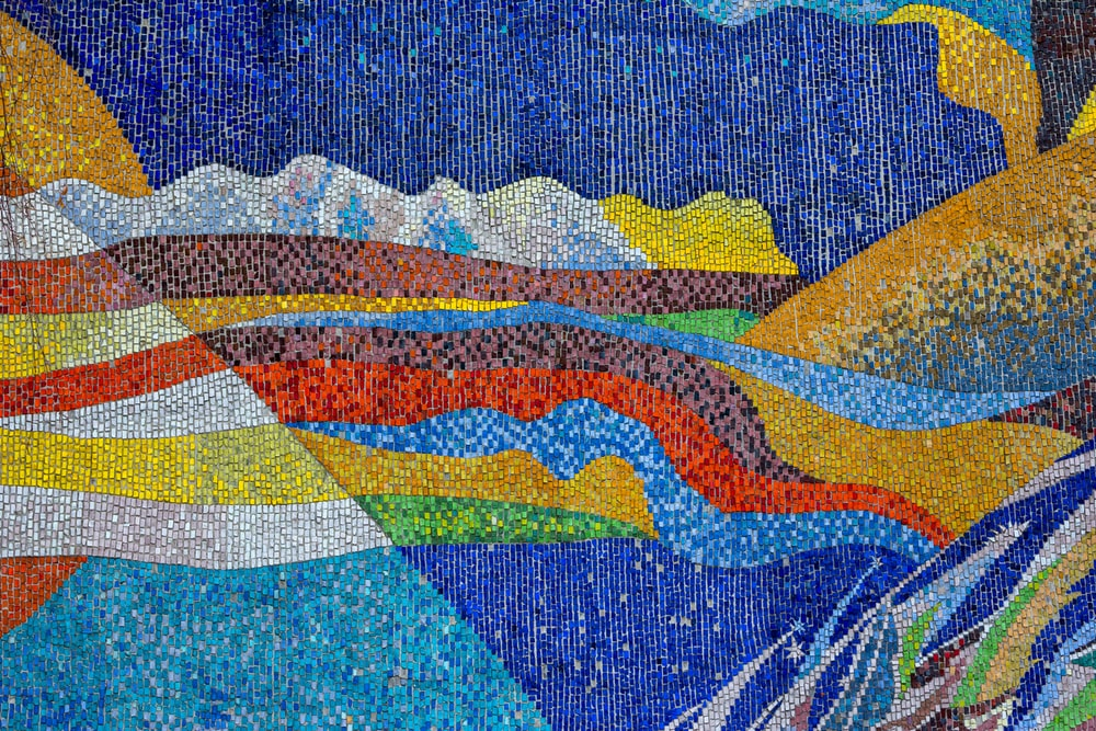 blue, yellow, red, and brown textile