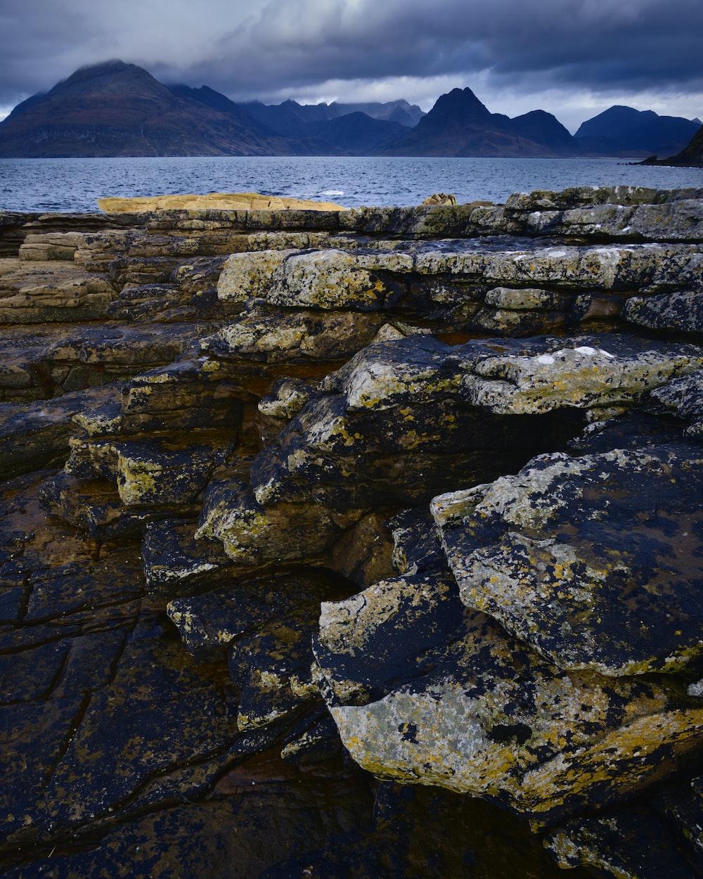 rock formation near calm ocean