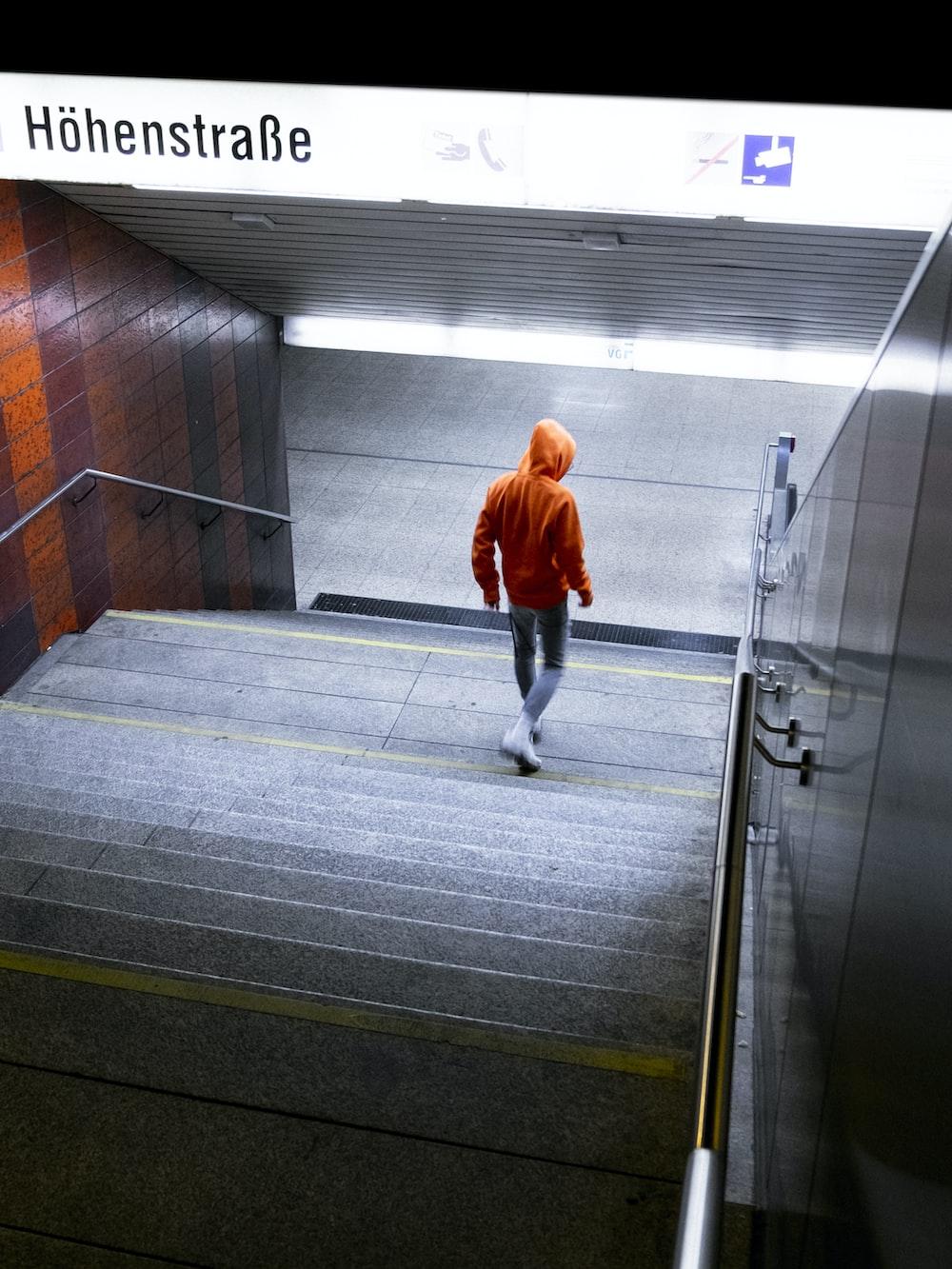 man wearing orange hooded jacket screengrab