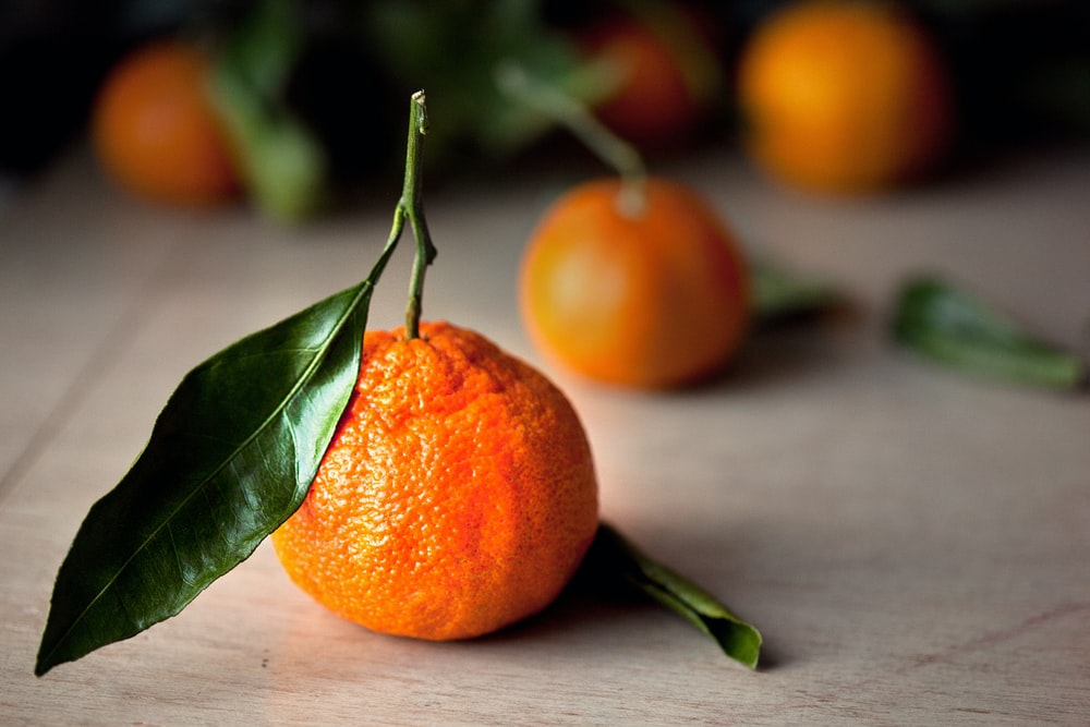 selective focus photography of orange tangerine fruits