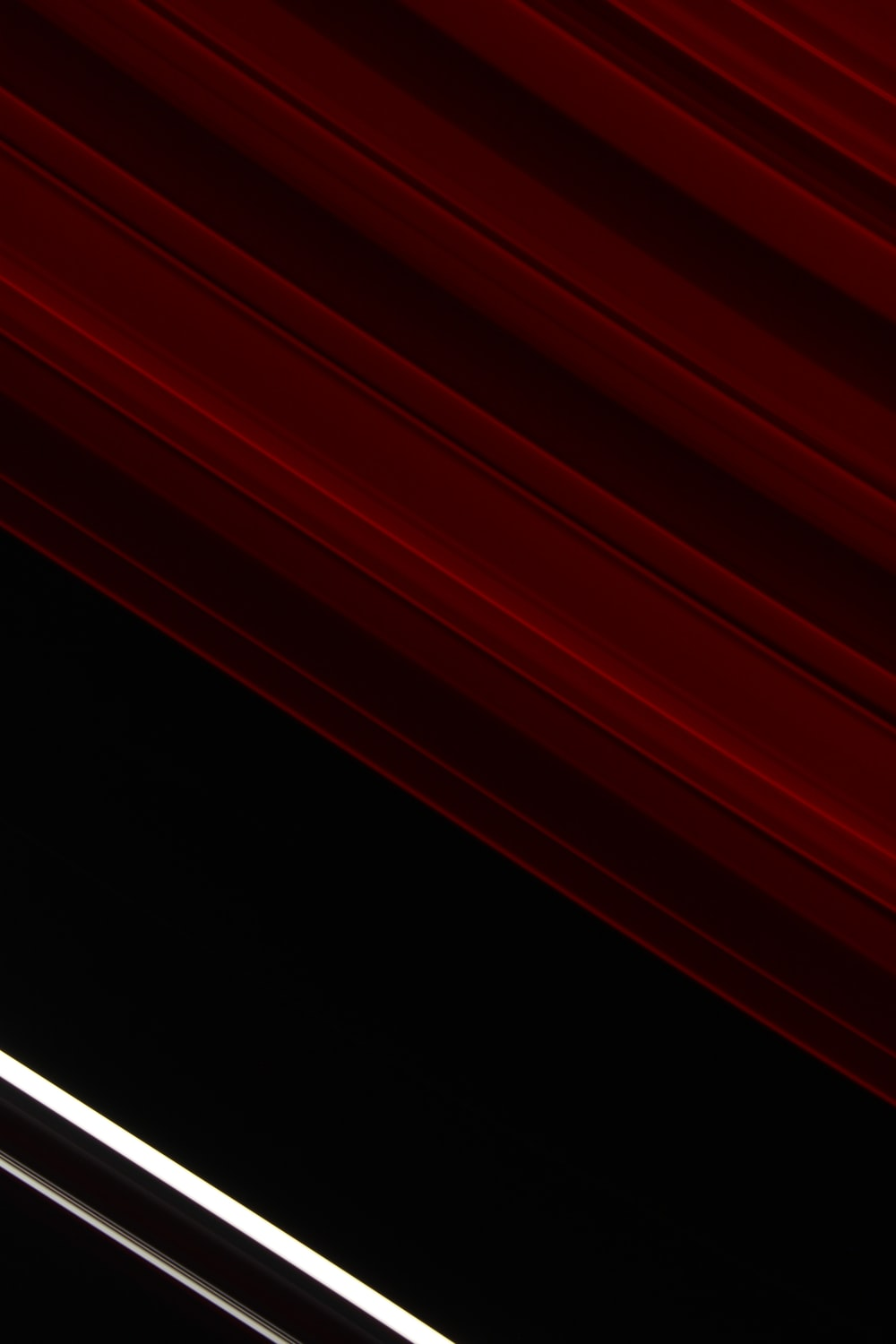 red stripes on a black background