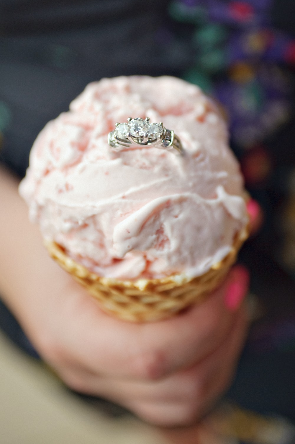 silver-colored ring on ice cream