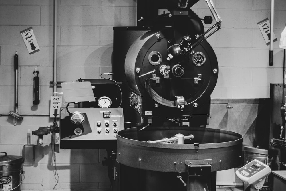 grayscale photo of industrial machine