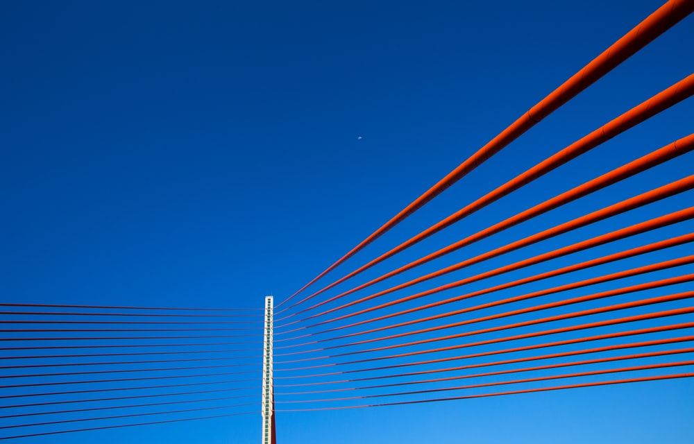 red suspension bridge during daytime