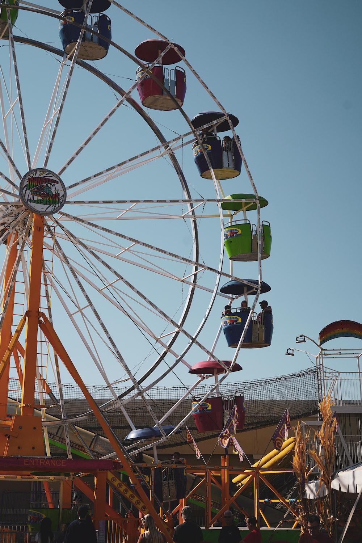 people riding ferris wheel during daytime