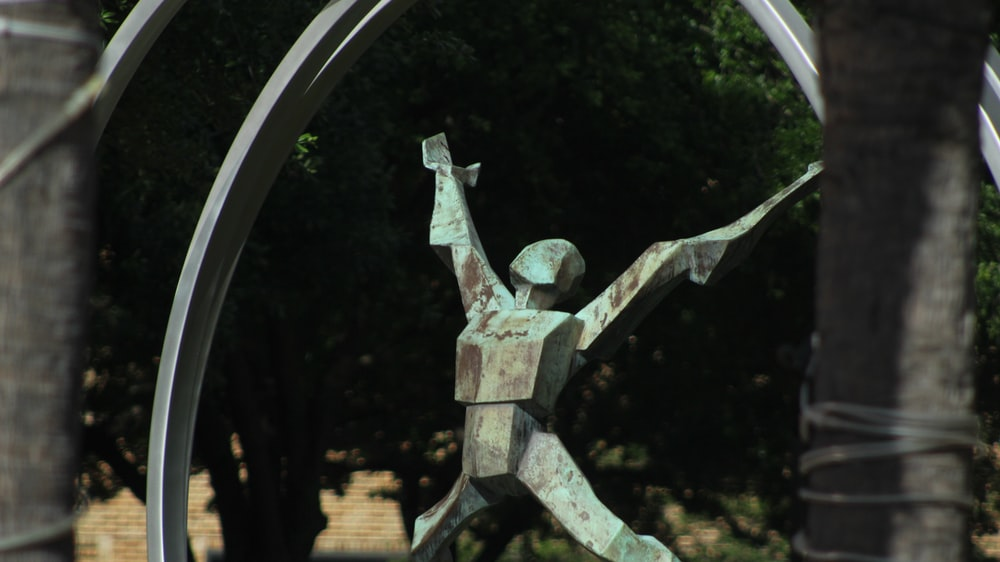 person raising hand statue